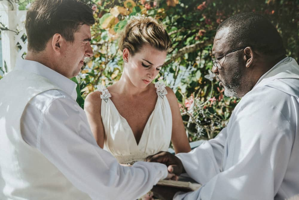Bride & Groom listening to officiant at their wedding