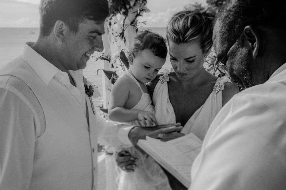Groom, Officiant, Bride & Daughter during the wedding ceremony