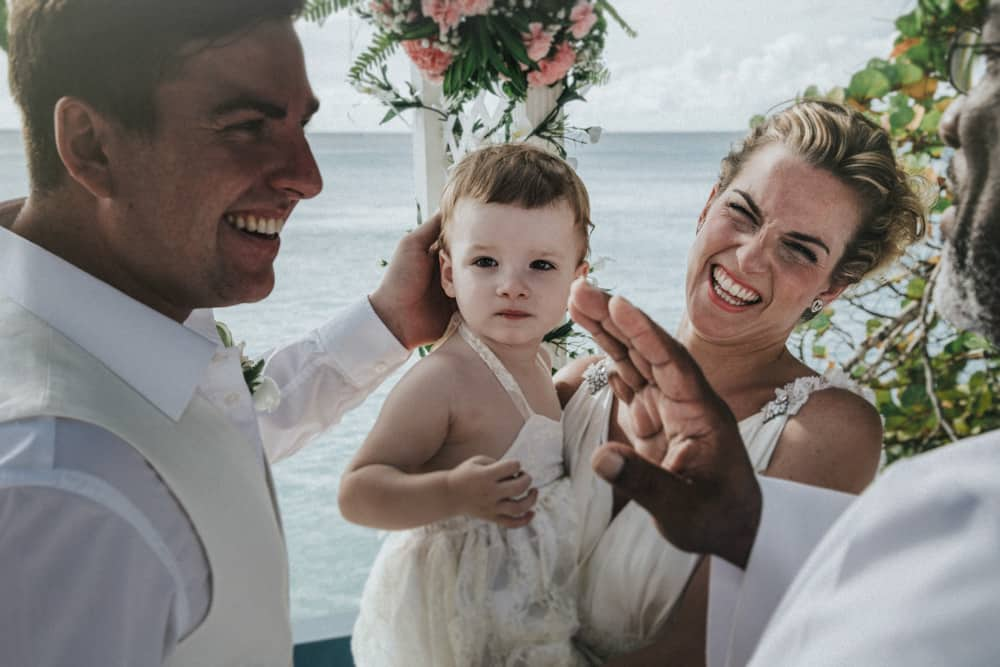 Bride, Groom laughing as daughter interupts wedding ceremony