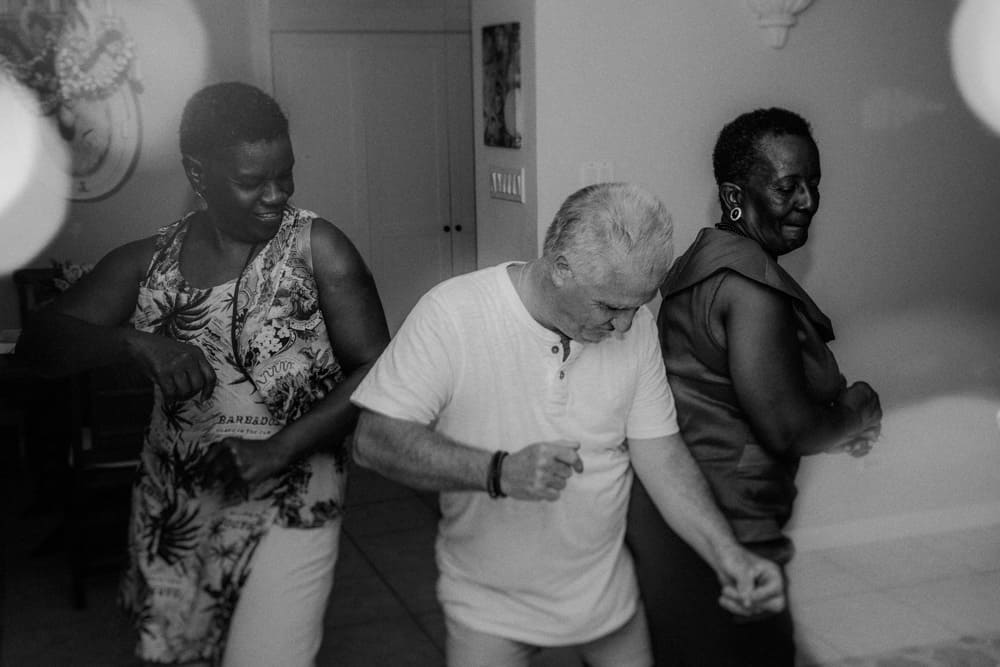 Father of the bride dancing with two Bajan guests