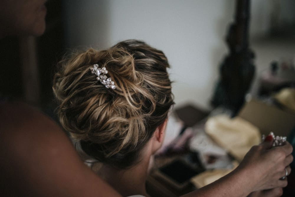 Bridal Hair clips being put into Brides hair as finishing touches