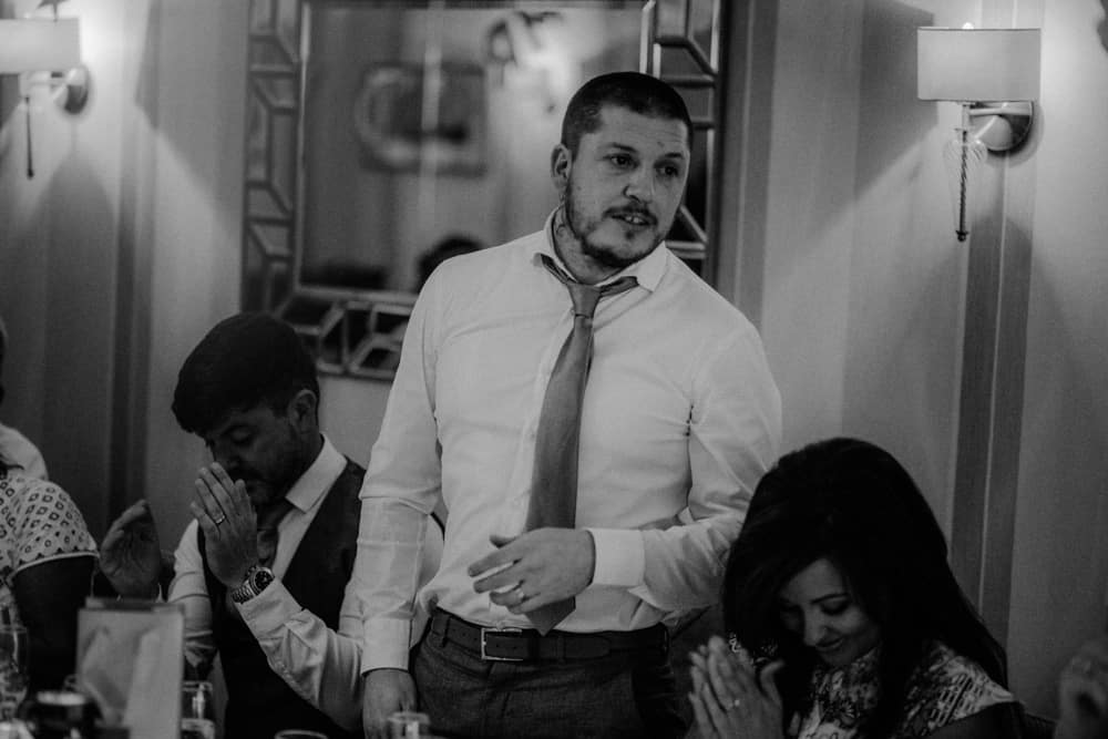Best Man giving speech during a small intimate wedding dinner