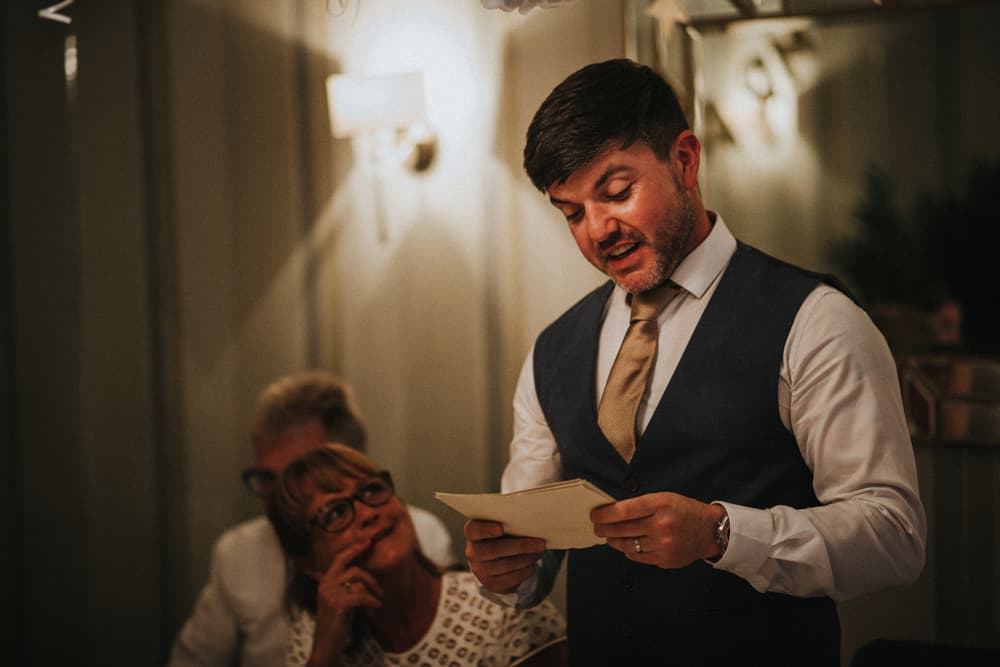 Best Man giving his speech at small intimate wedding