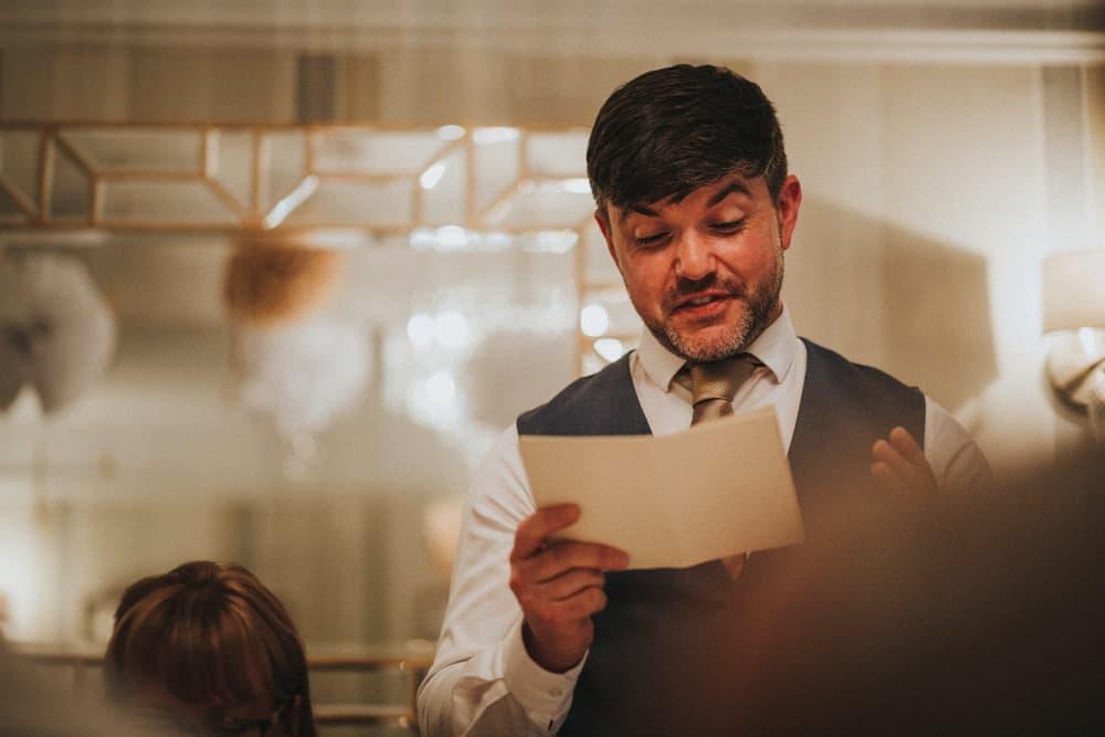 Bestman giving his speech at small wedding dinner