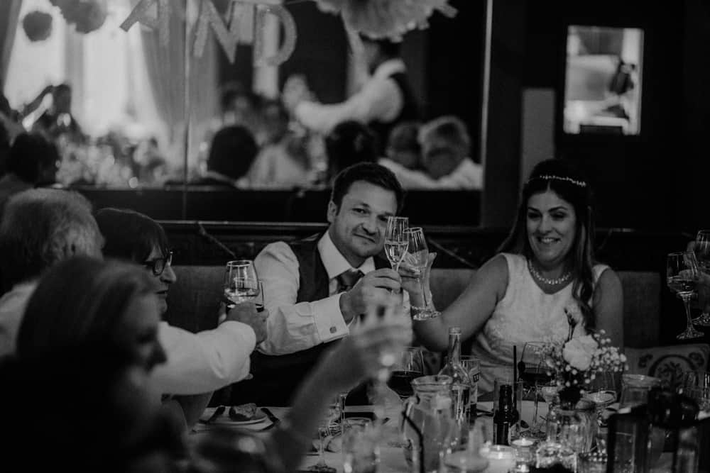 Bride & Groom toasting during wedding dinner