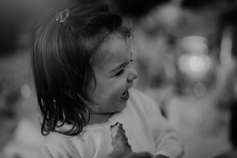Little girl laughing during a wedding