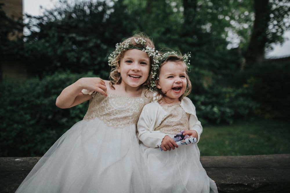 Two flower girls laughing