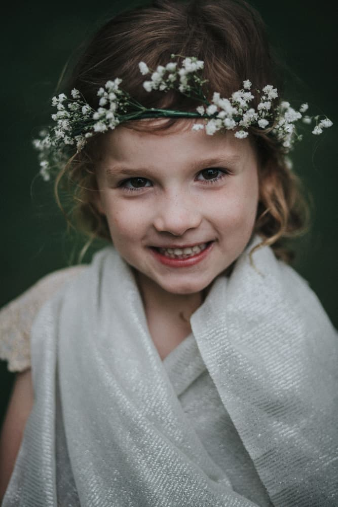 Flower Girl wrapped in shawl with headband made of gypsophila
