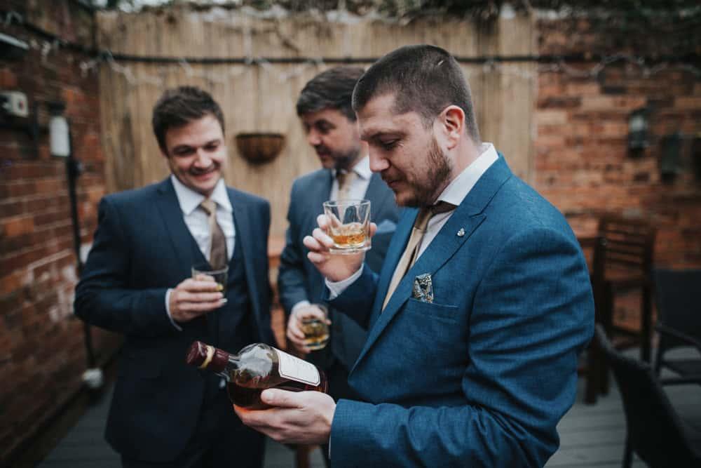 Groom and best men drinking Barbados Rum