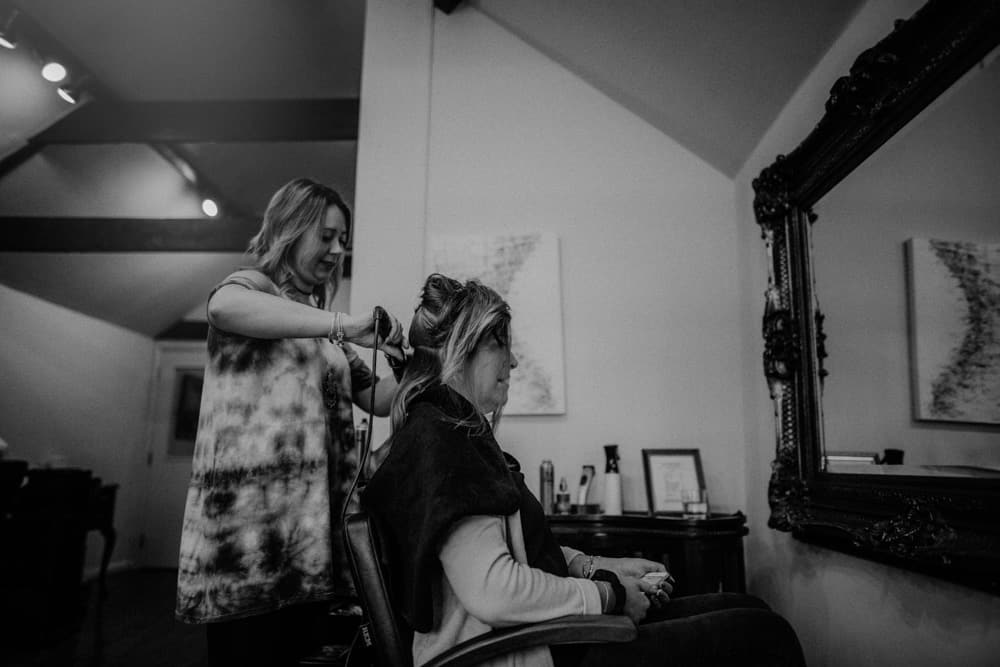 Bride having her done by hair dresser