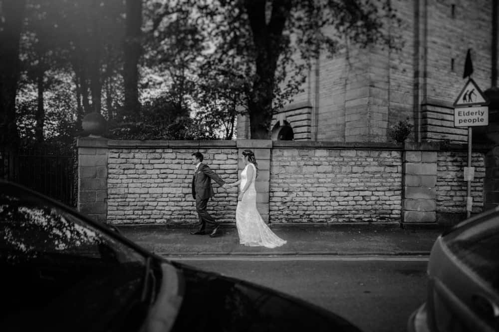Bride & Groom walking along street in Lincoln