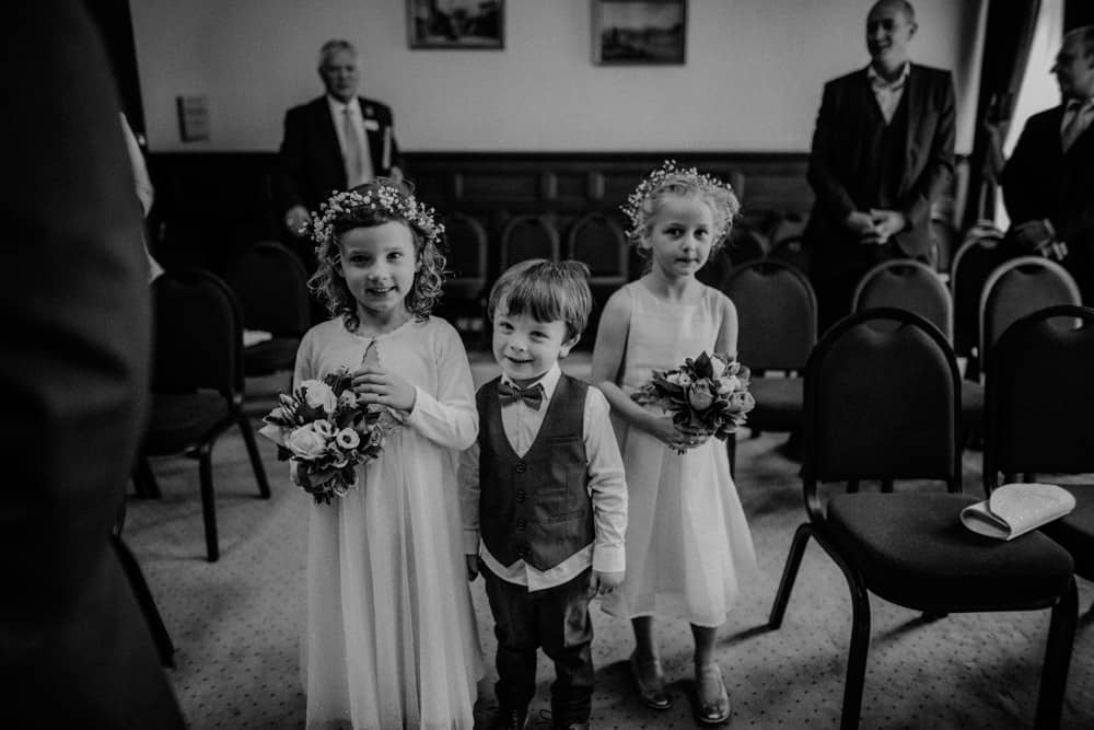 Flowergirls and page boy walking down the aisle