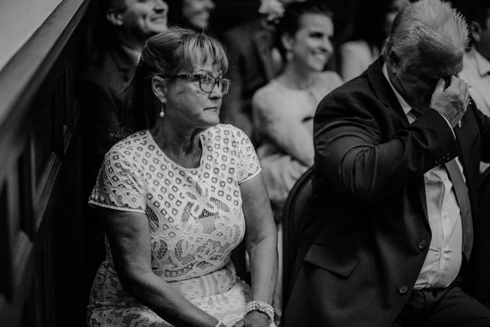 Mother of groom watching as her son marries