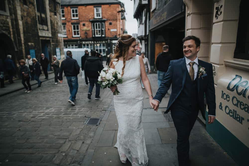 Bride & Groom walking through streets of Lincoln