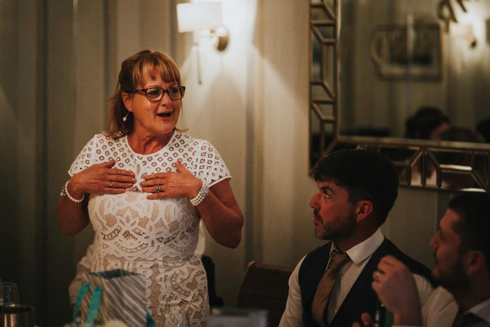 Mother of groom giving speech to a small intimate wedding party