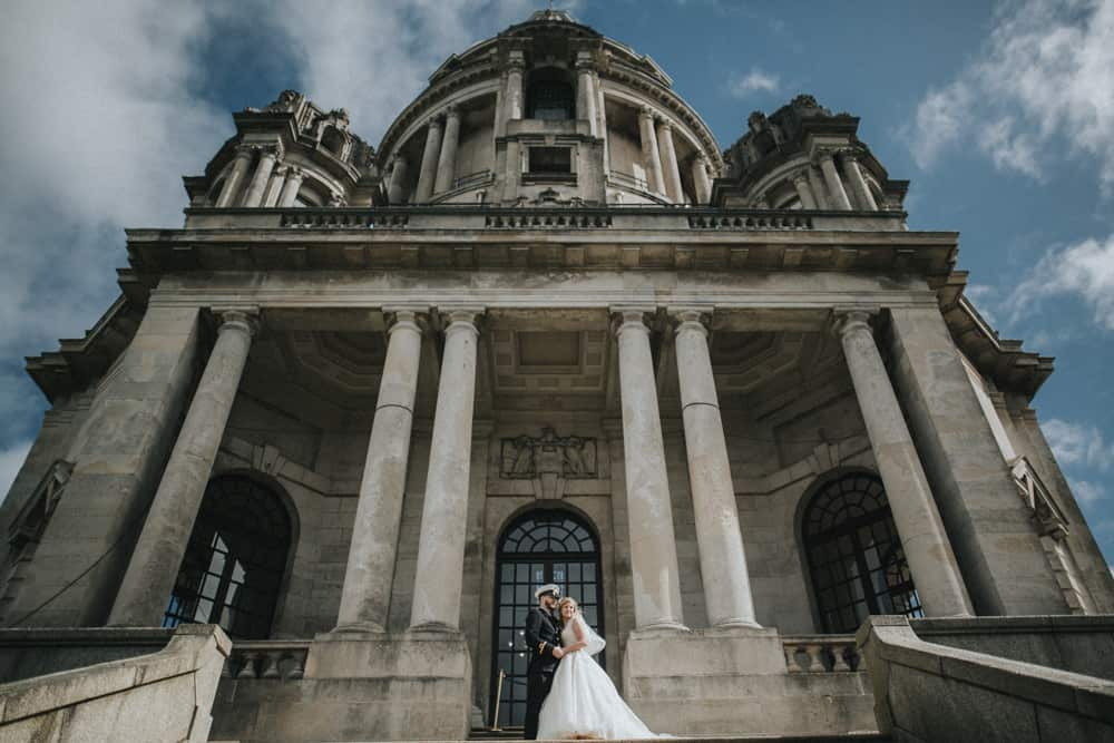 Bride and Groom pose for their portrait shoot after their wedding at the Ashton Memorial in Lancaster