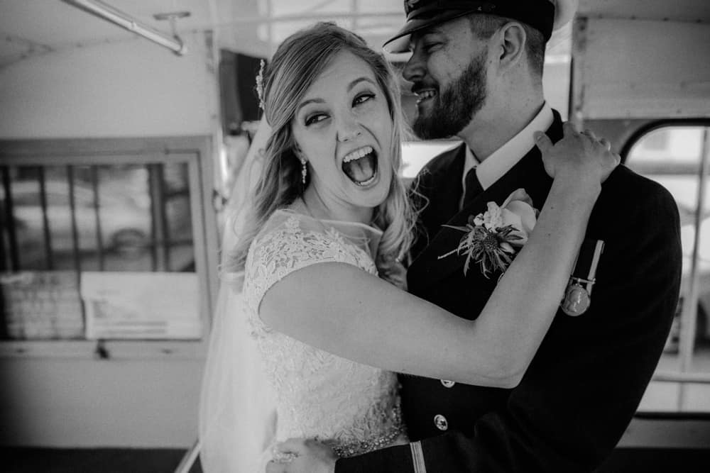 The married couple have their photo taken on the bus laughing and smiling after saying I do