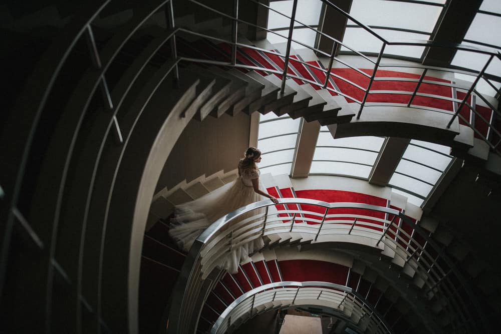 Bride walks down the epic staircase at the Art Deco Midland Hotel in Morecambe on her way to say I do