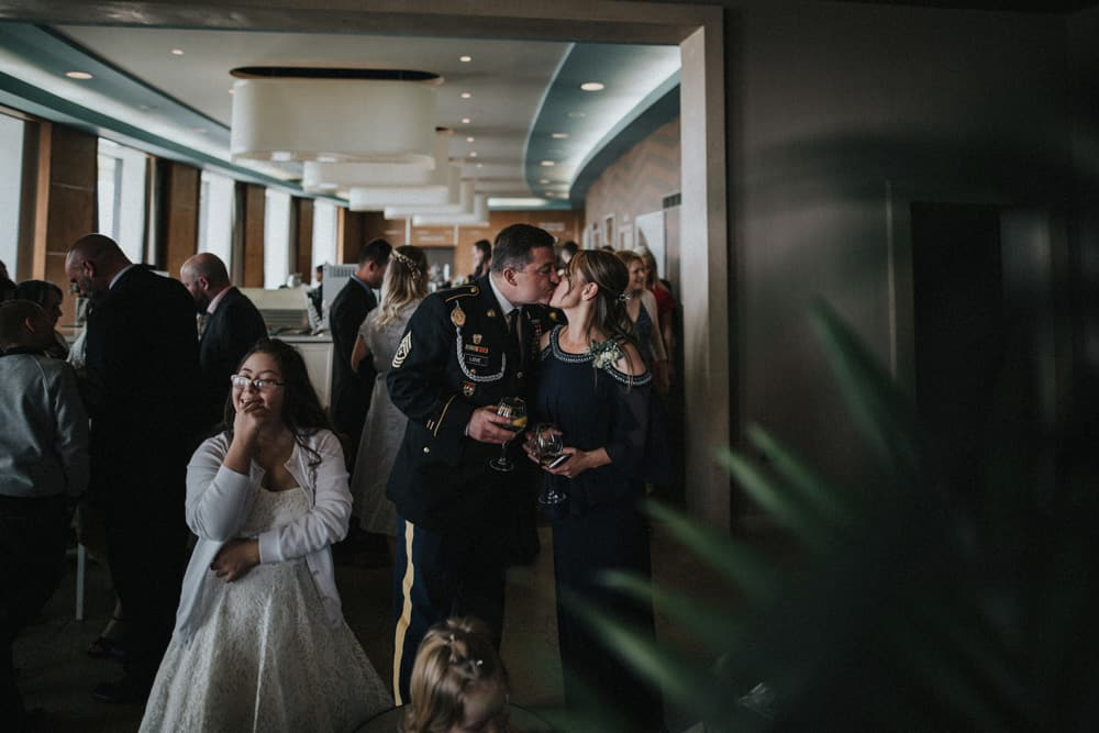 Father of the Bride kisses his wife during the drinks reception at the Midland Hotel in Morecambe