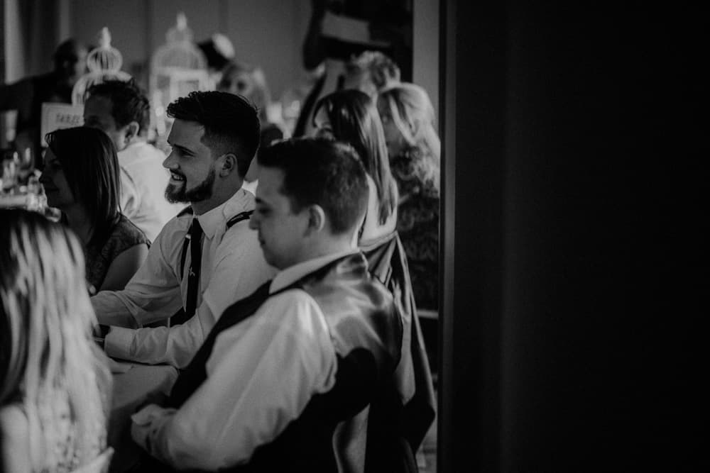 Guests looking on at the wedding speeches