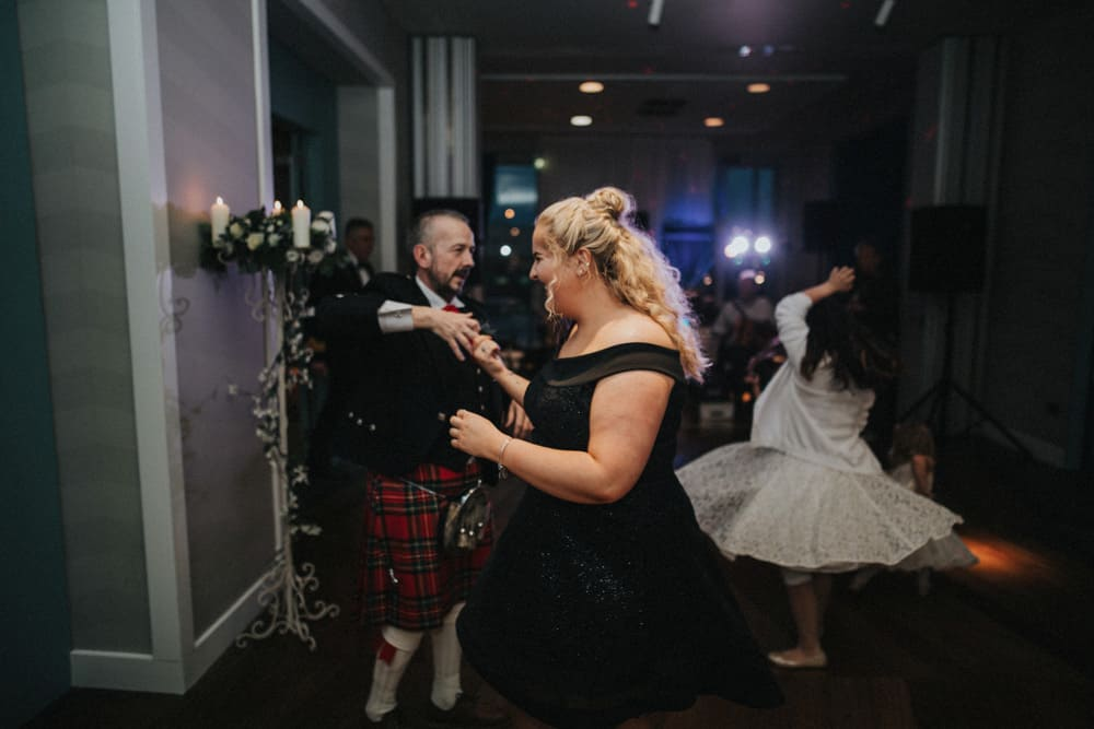 Guests all dancing at the wedding evening reception