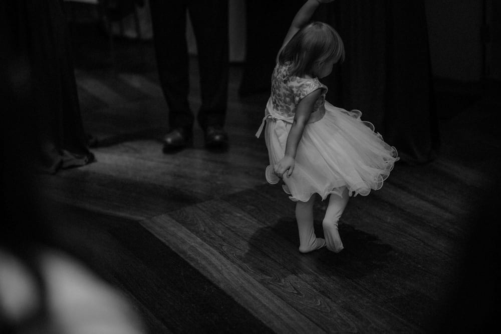 Little girl dances at the wedding evening reception
