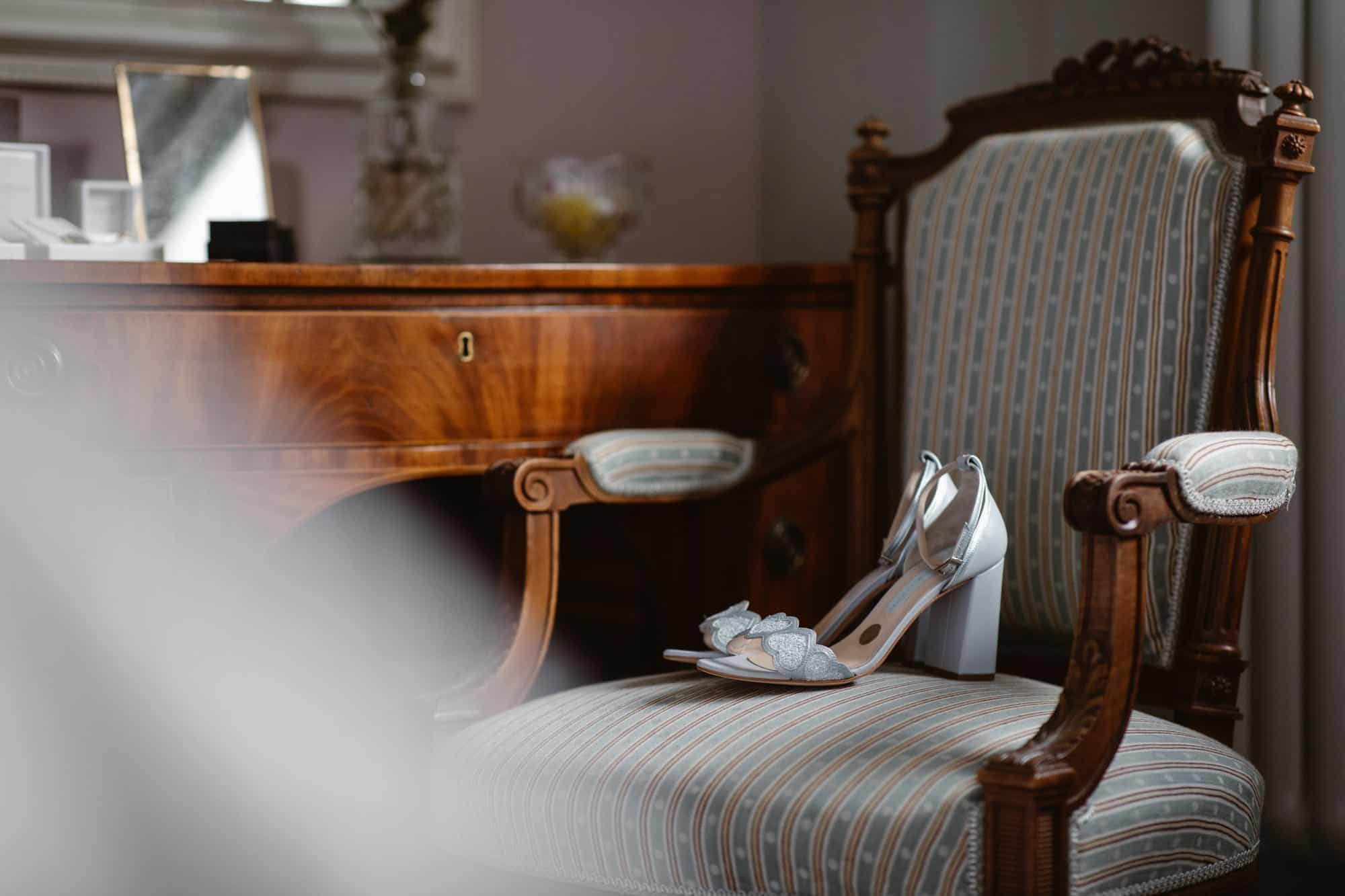Wedding shoes on a chair awaiting the bride