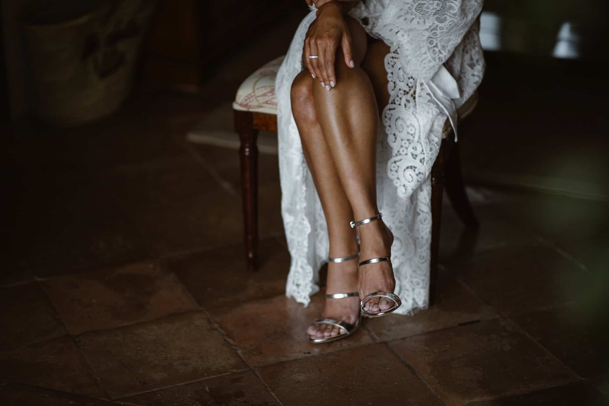 Bride crossing legs with Jimmy Choo shoes on