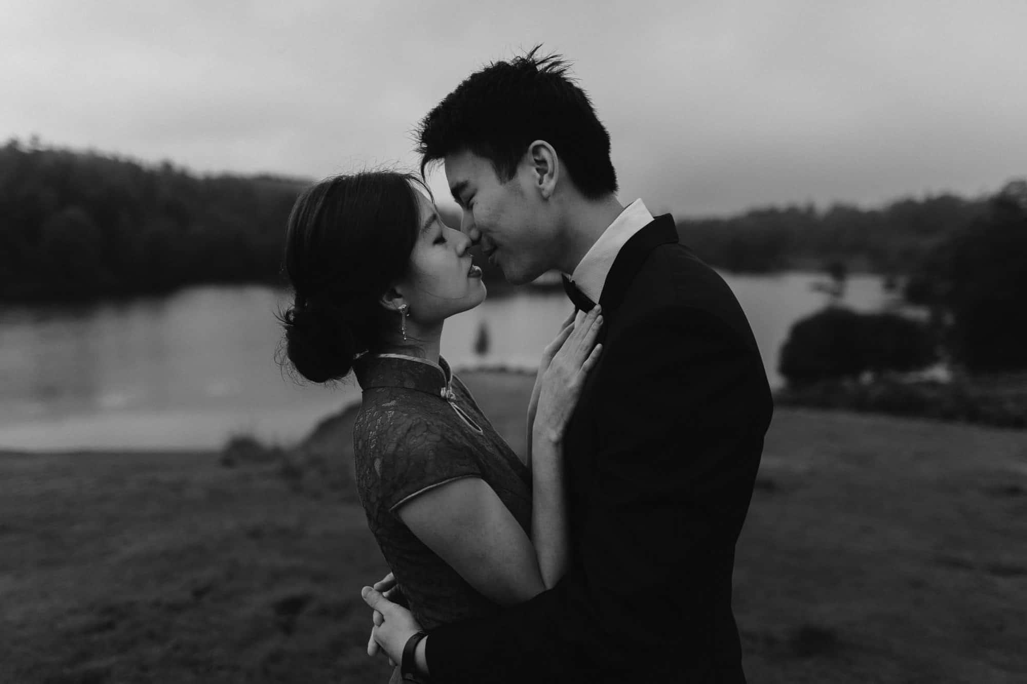 Hong Kong couple kiss at Tarn Hows