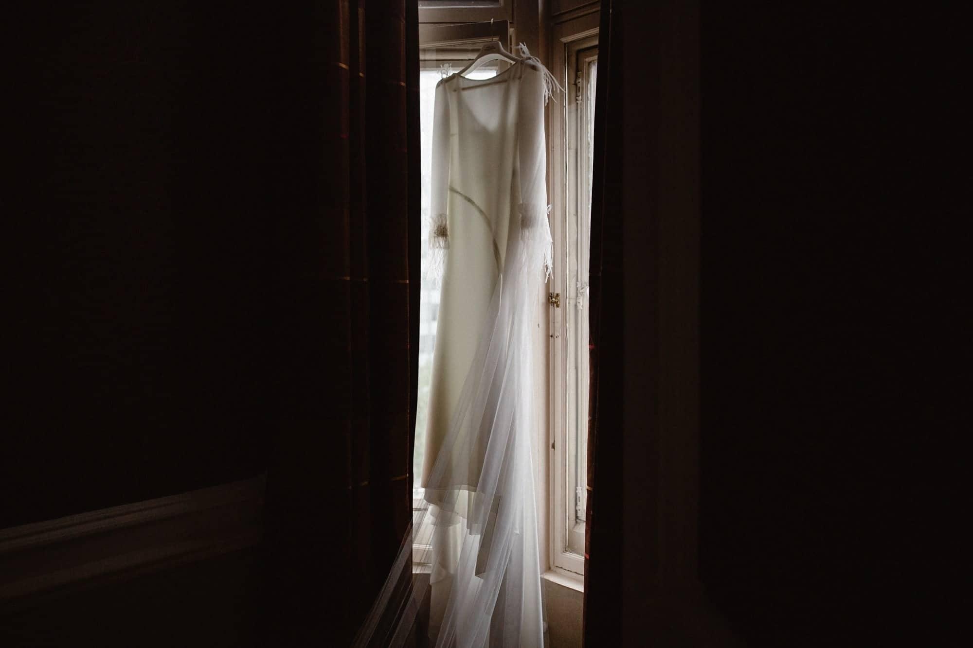 Pronovias Atelier wedding dress hanging in the window