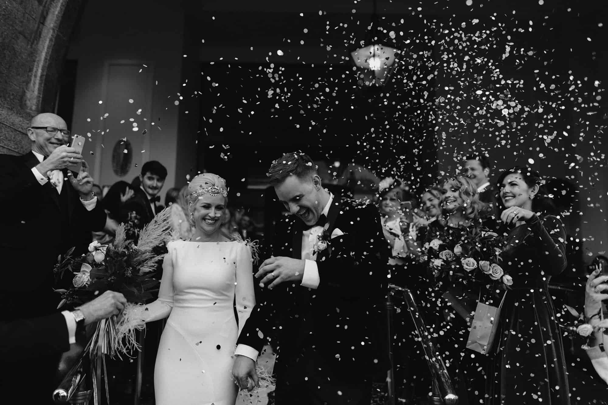 Bride and Groom with confetti cannons