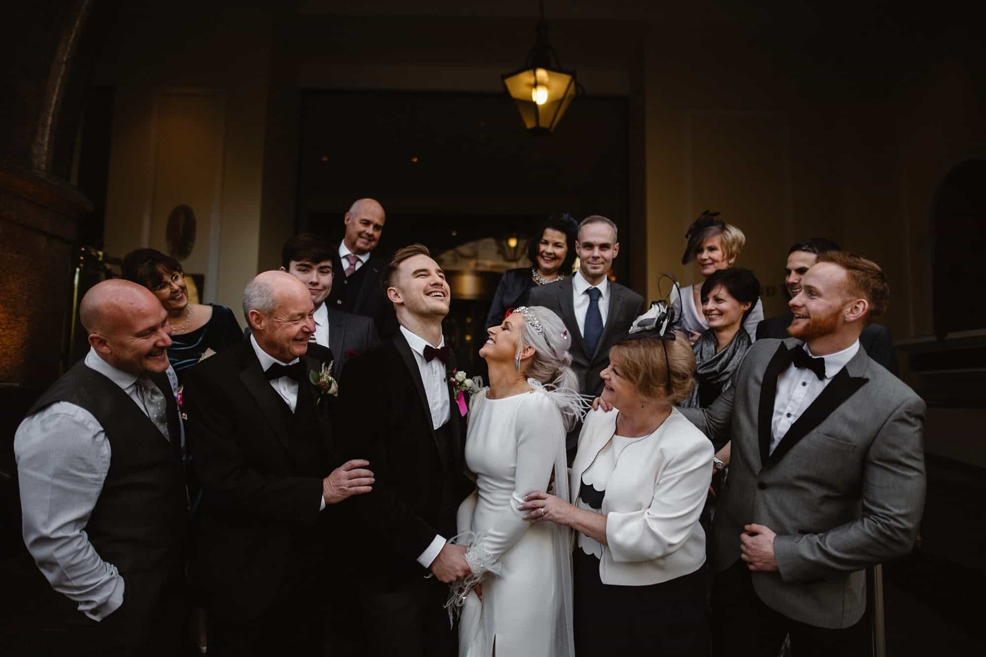 Wedding party all laughing