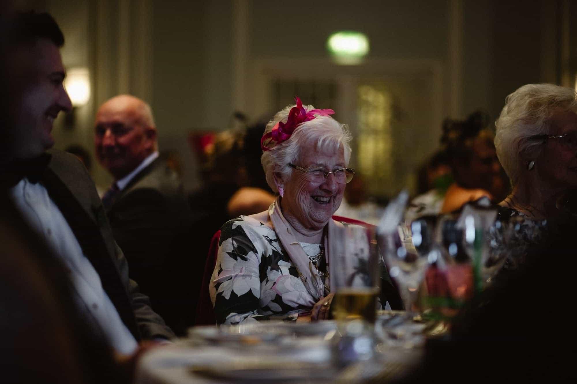 Grandma laughing during wedding speeches