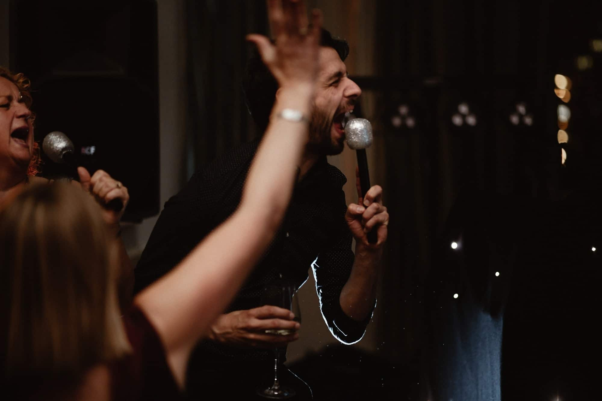 Wedding guest with microphone singing