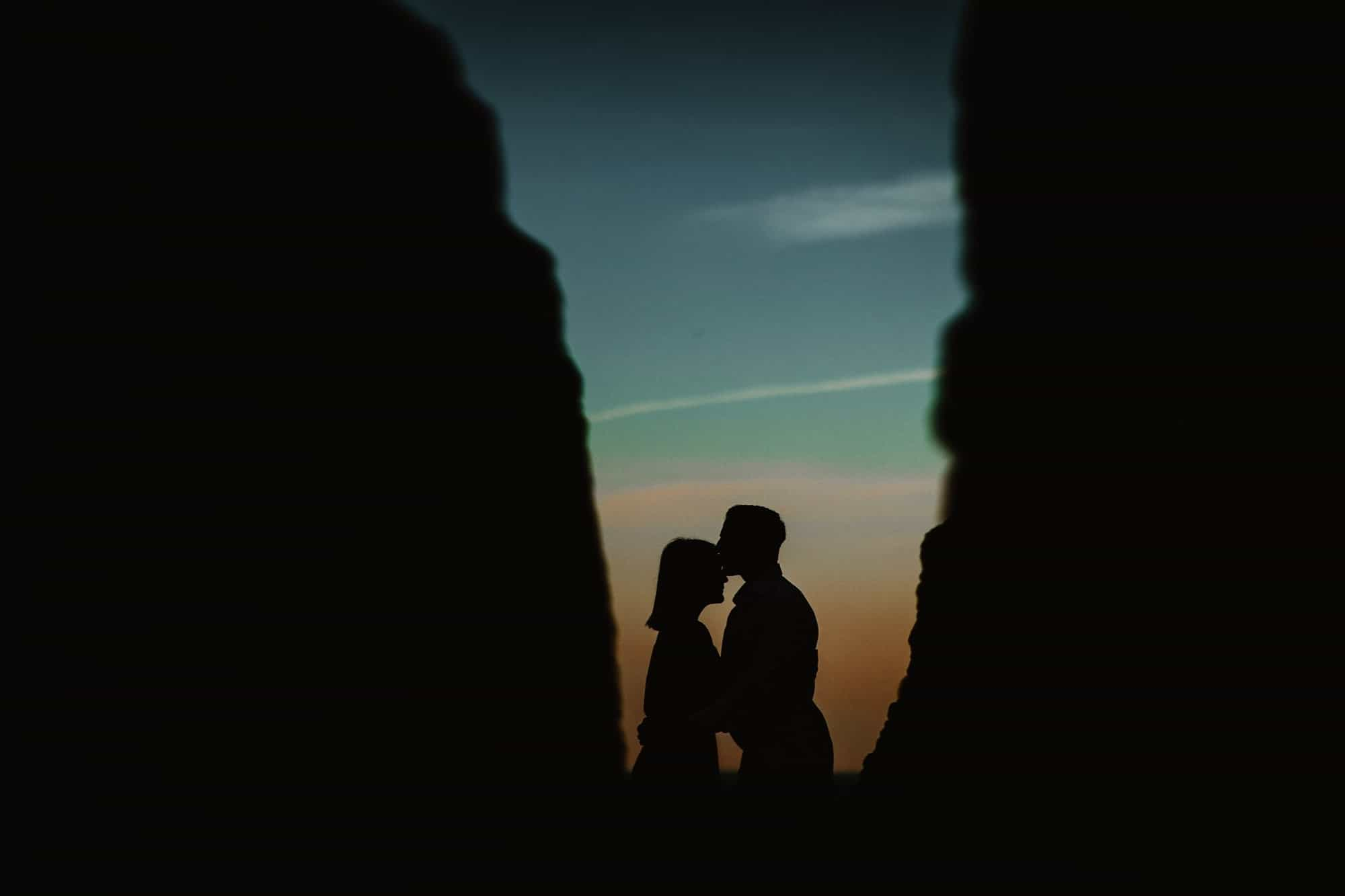 Couple kissing in the shadows at Algar Seco at Sunrise