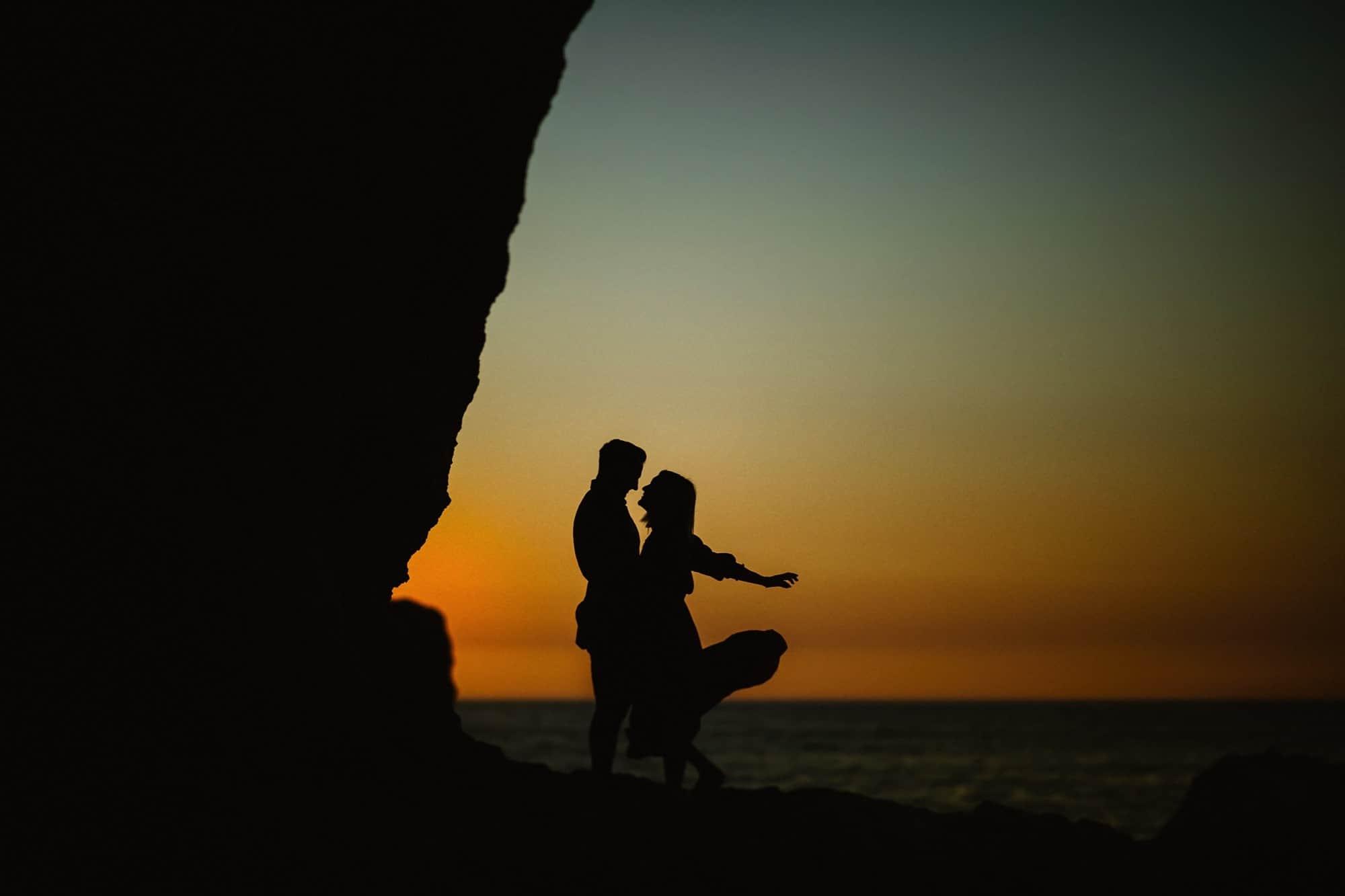 Sunrise image of a couple on the rocks at Algar Seco, Faro