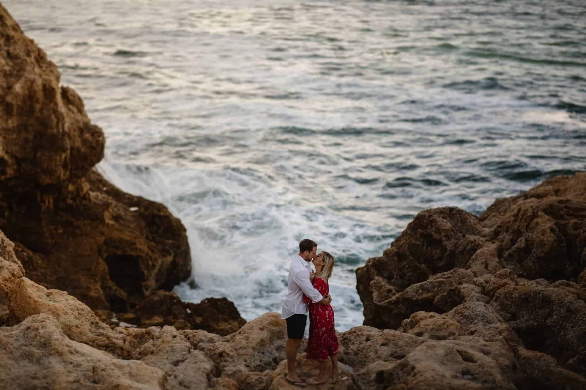 Couple on the rocks at Algar Seco in Carvoeiro, Portugal
