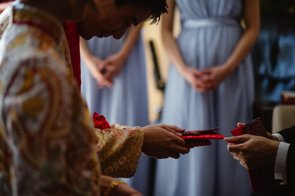 Groom presenting gifts as part in the Hong Kong Wedding tradition of Ging Chaa or the Tea Ceremony