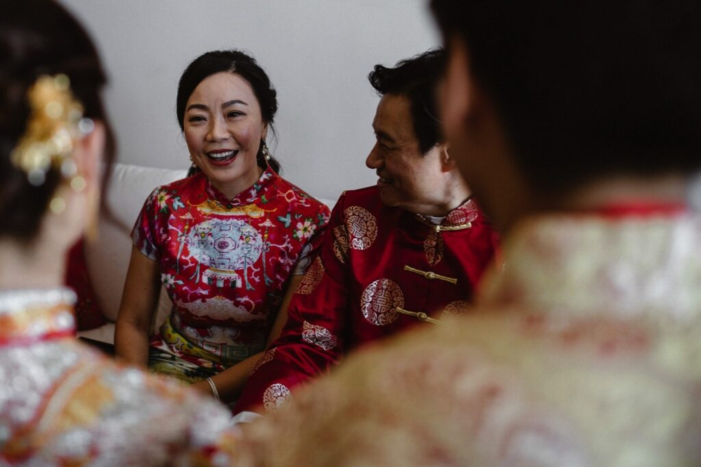 Groom's parents taking part in the Hong Kong Wedding tradition of Ging Chaa or the Tea Ceremony