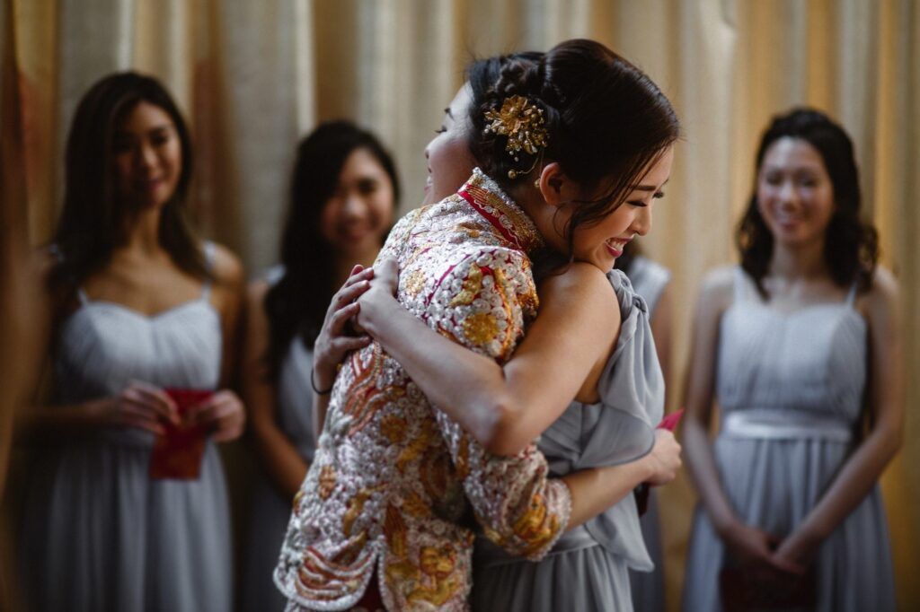 Bride hugging one of her bridesmaids