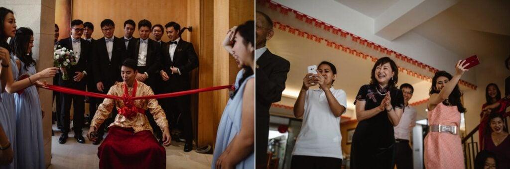 Groom undertaking Hong Kong wedding tradition of Jip San Leung or The Door Games as bridal party watches.