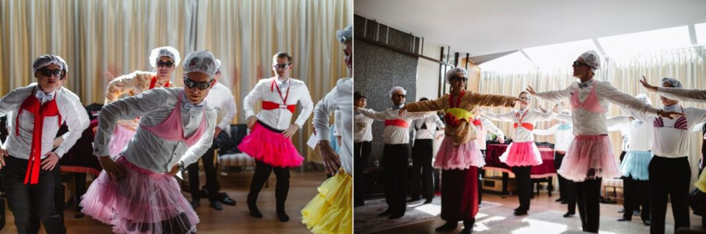 Groomsmen dressed in bra's, tutu's and showercaps dance as part of Jip San Leung or The Door Games.