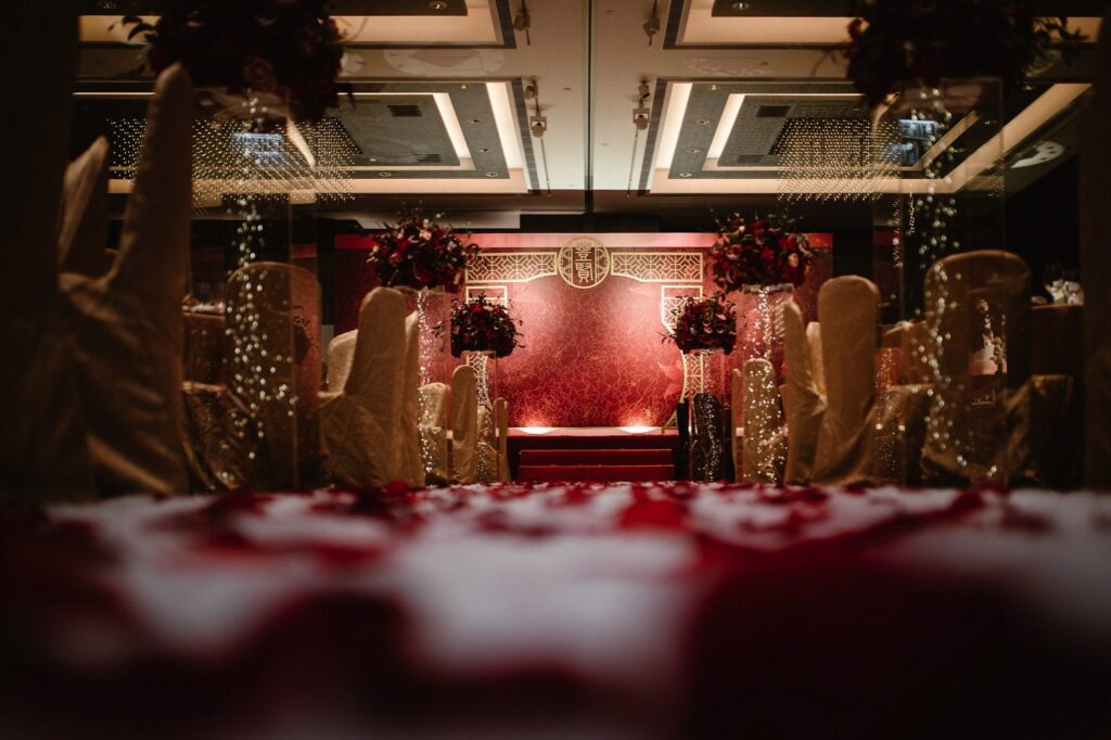 Interior of Hong Kongs wedding venue's JW Marriot, Pacific Place's reception room decorated in red and gold