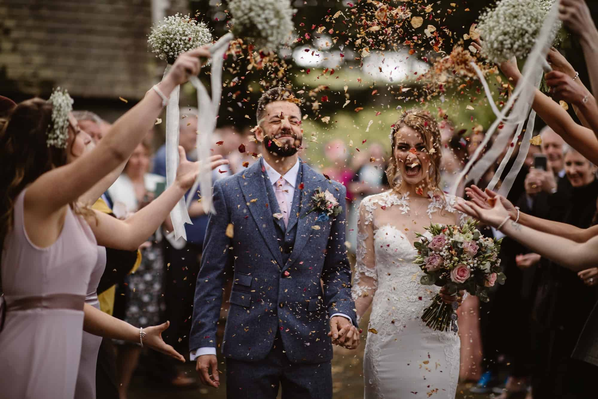Bride & Groom being showered in confetti
