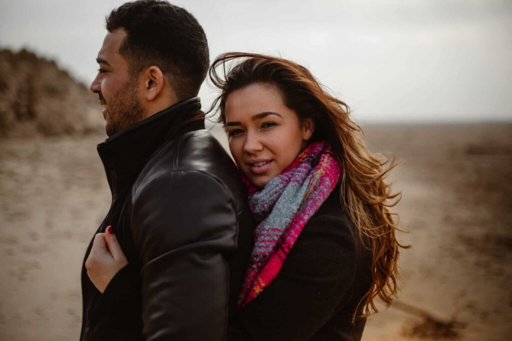 Newly engaged couple on the beach at Formby National Park