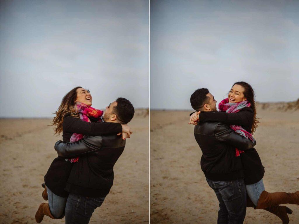 Man swinging fiancee around on Formby Beach